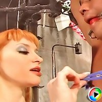 Smoking redhead mistress pinching slave's nipples, cock and balls with pins
