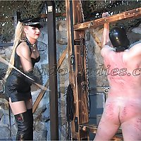 Blond goddess in black leather gives a slave a hard caning.