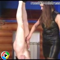 Miss Stella hangs her elderly slave headlong and takes care of his penis.