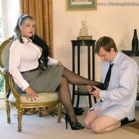 Mistress Birch enjoys a sunny day while her slave butler serves and pleasures her, and is punished for his transgressions.