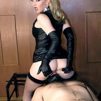 Mistress Sidonia teases her slave then makes him pleasure her.