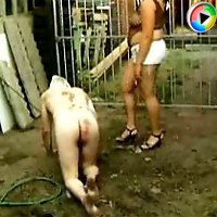 Abused slave getting naked in the garden