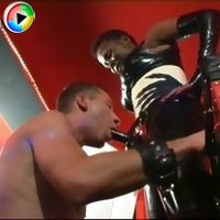 Black mistress fucks her male slave with strapon dildo