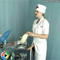 Perverted nurse stretches her male patient's ass with a massive strapon toy