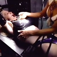 Female slave in bondage is submitted to a serious domination session